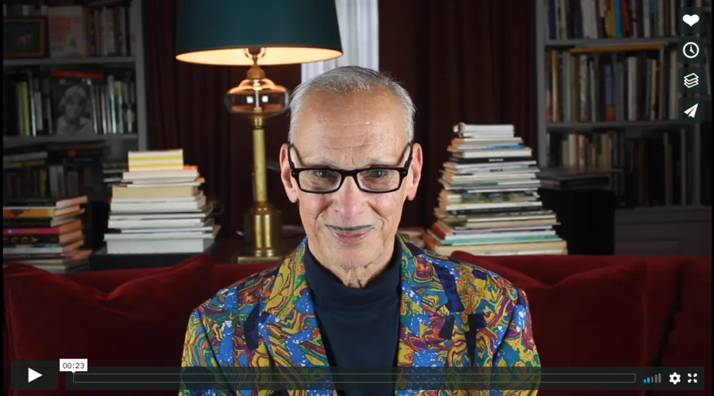thumbnail of john waters seated looking into the camera, click to view video